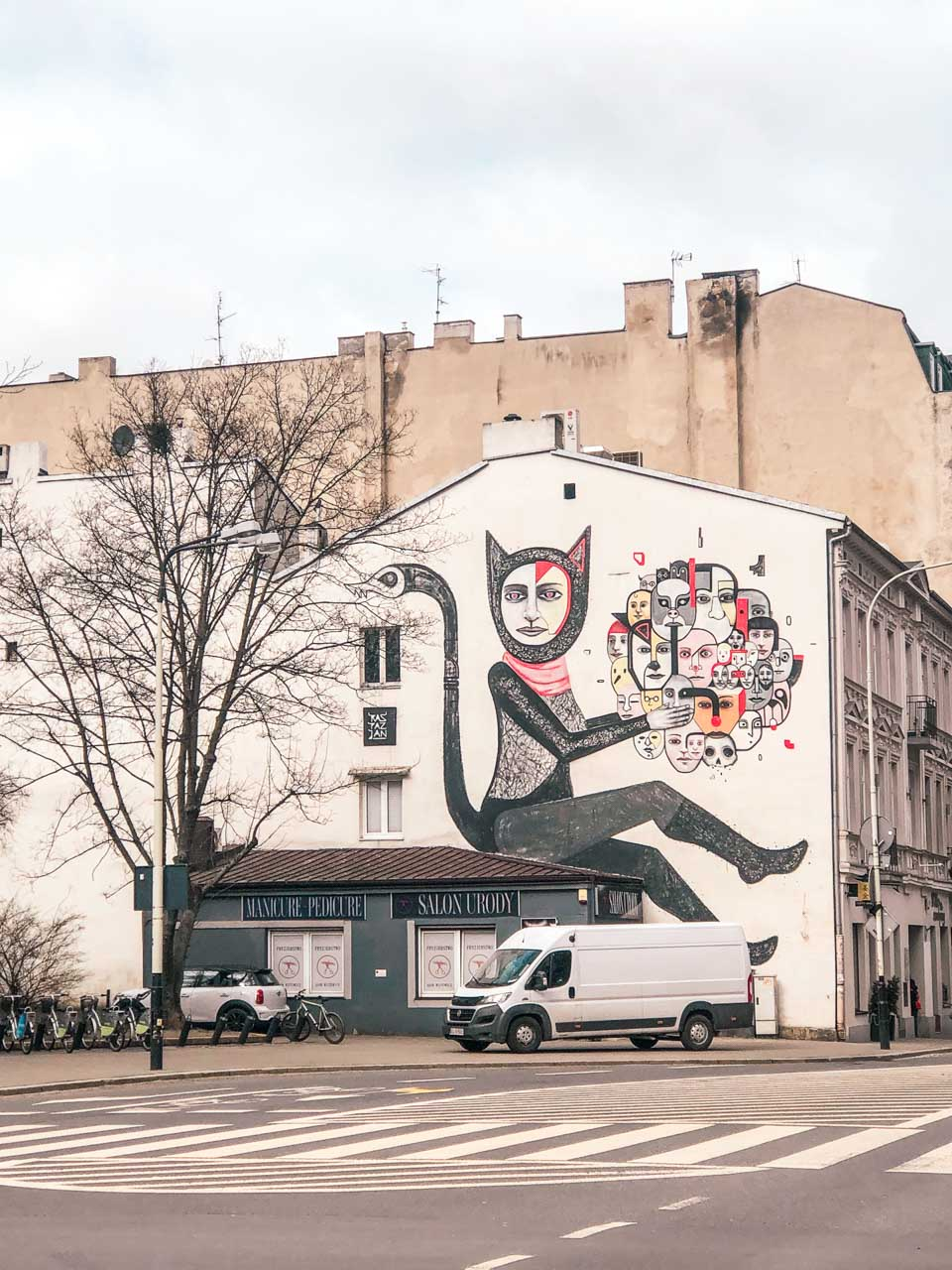 Cat lady mural in Łódź, Poland