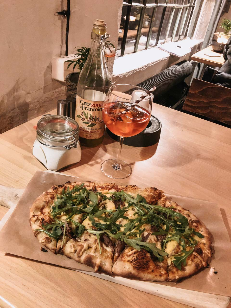 A pide pizza and an Aperol Spritz