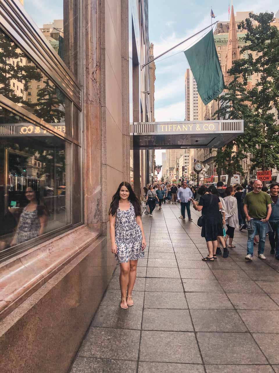 A girl standing outside the Tiffany's flagship in New York City