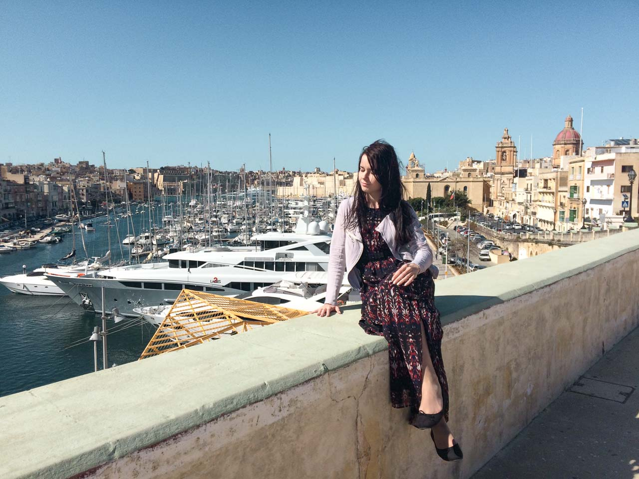A girl in Grand Harbour Marina in Birgu / Vittoriosa, Malta