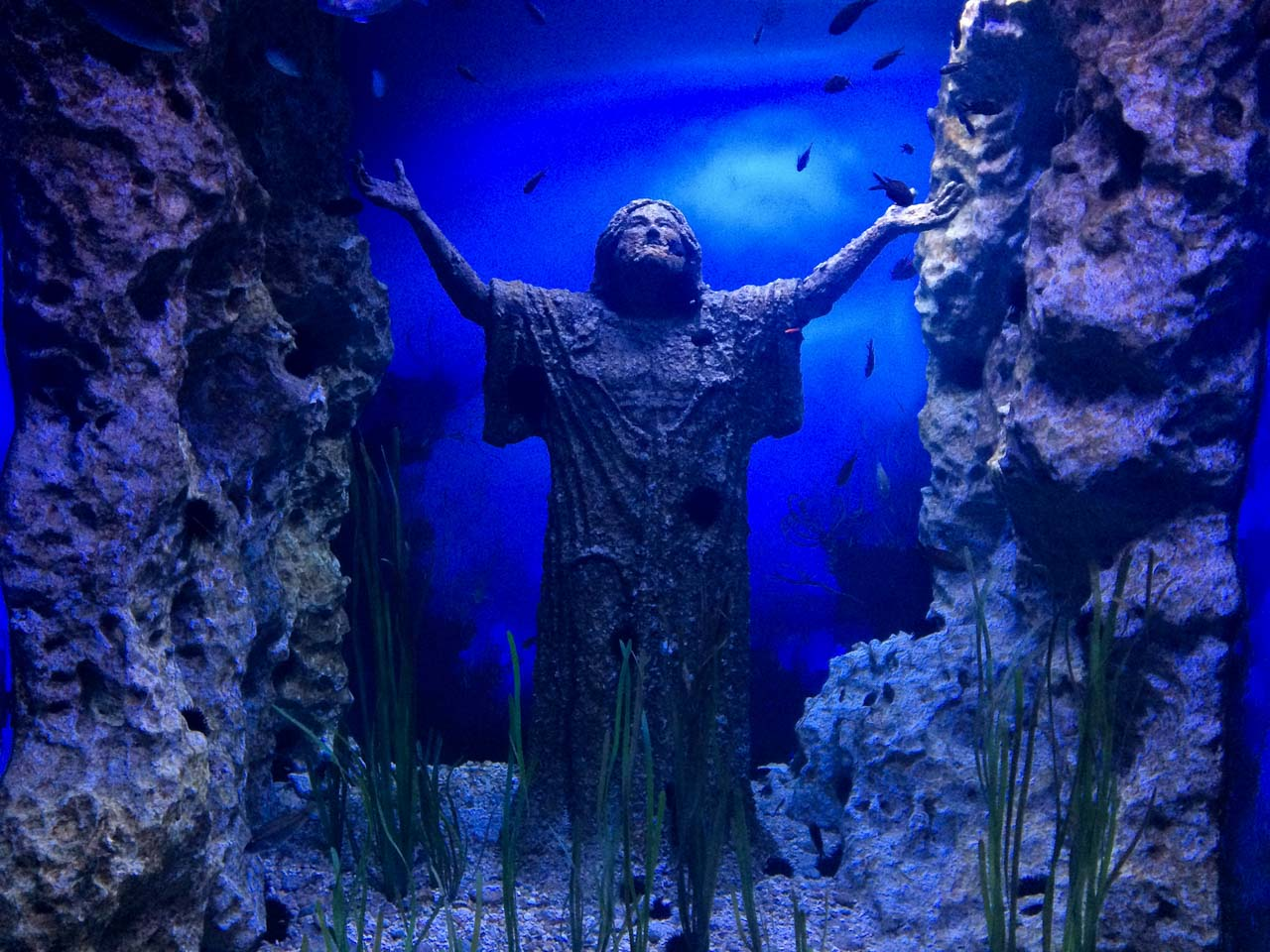 A bronze Christ of the Abyss statue in Malta National Aquarium