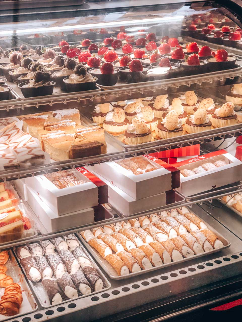 Various cupcakes, tartelettes and cannolis on display inside Carlo's Bake Shop in Hoboken, New Jersey