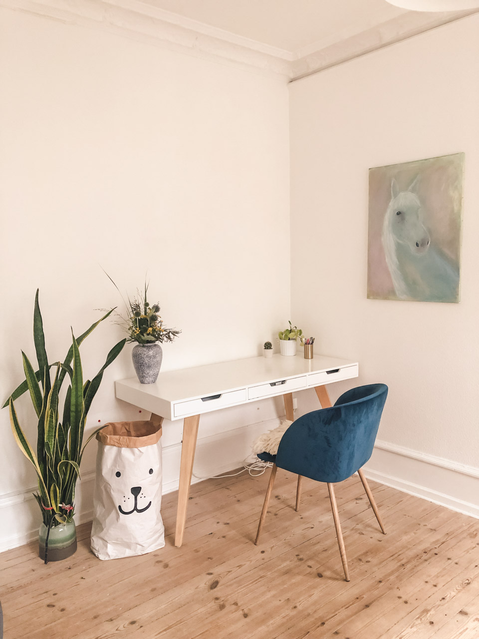 A desk with a chair inside a traditional Scandinavian apartment