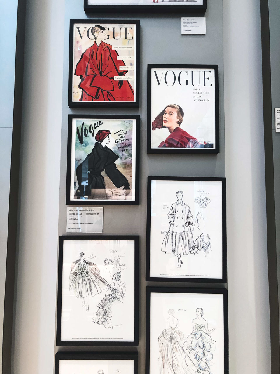 Framed Vogue covers and Dior sketches on the wall of Victoria and Albert Museum in London