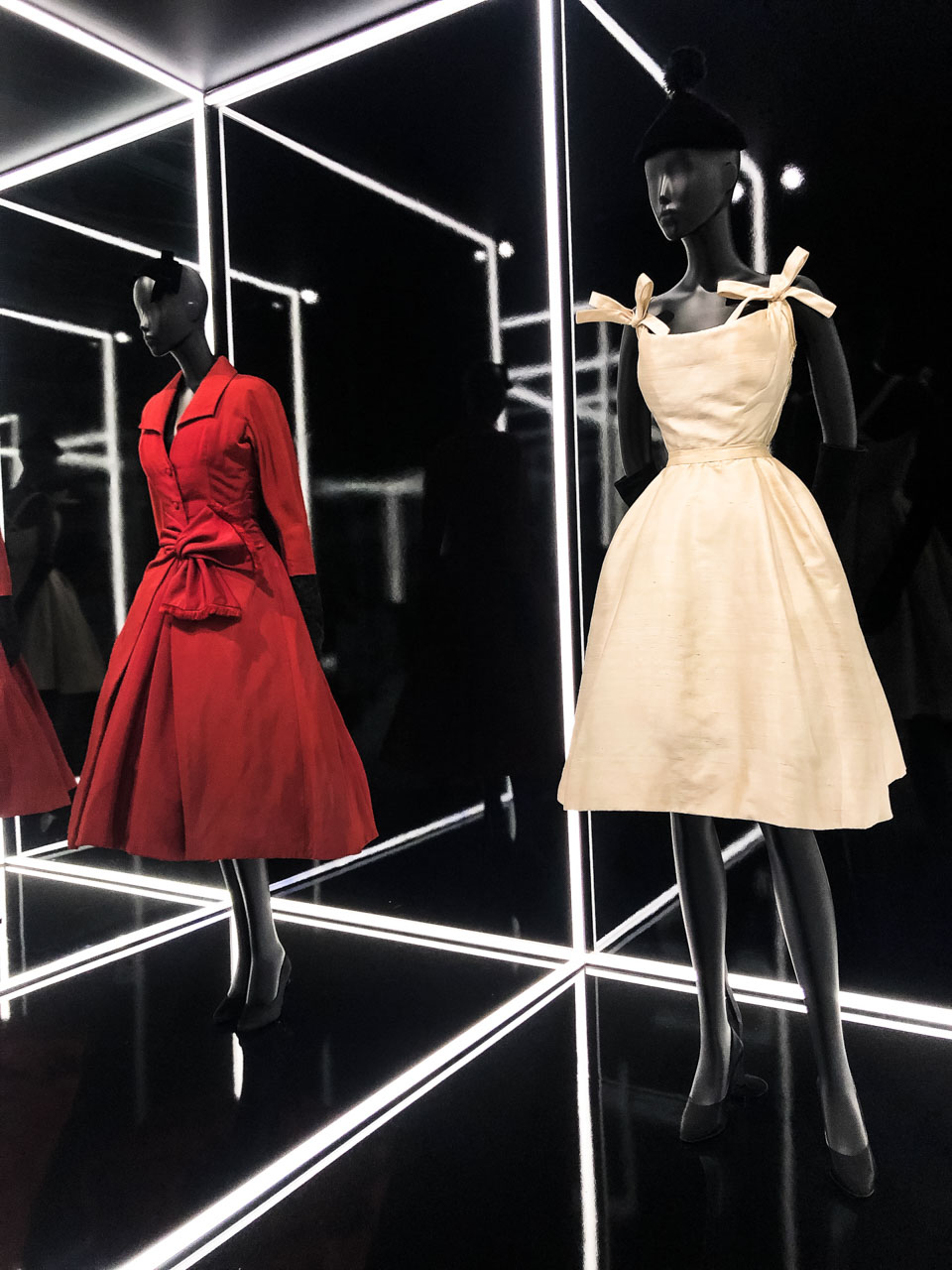 A Dior coat and dress at the Victoria and Albert Museum in London