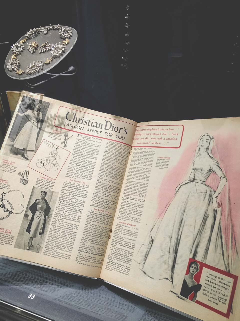 A book with Christian Dior's fashion advice on display at the Victoria and Albert Museum in London