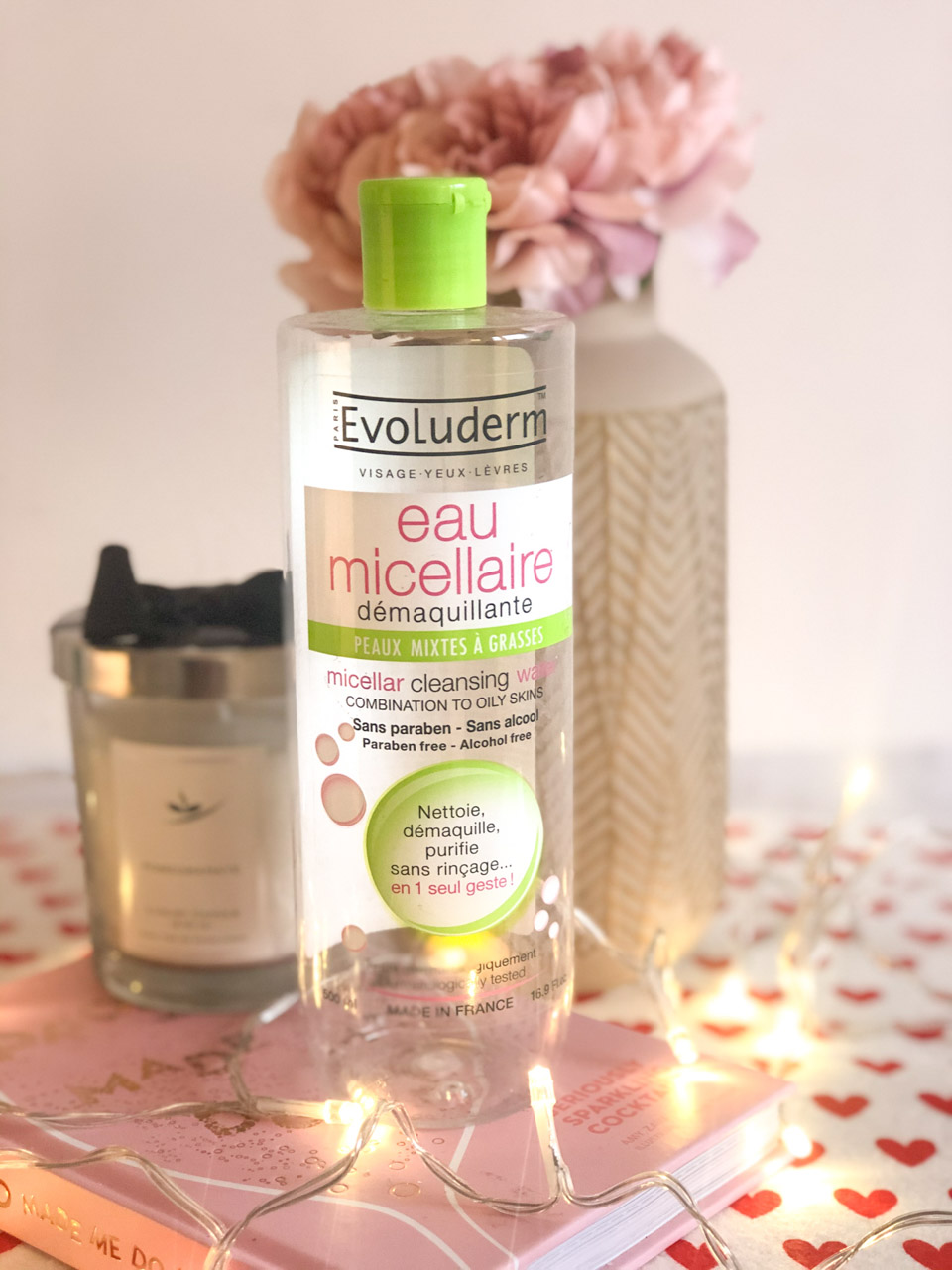 A bottle of Evoluderm micellar water standing on a desk