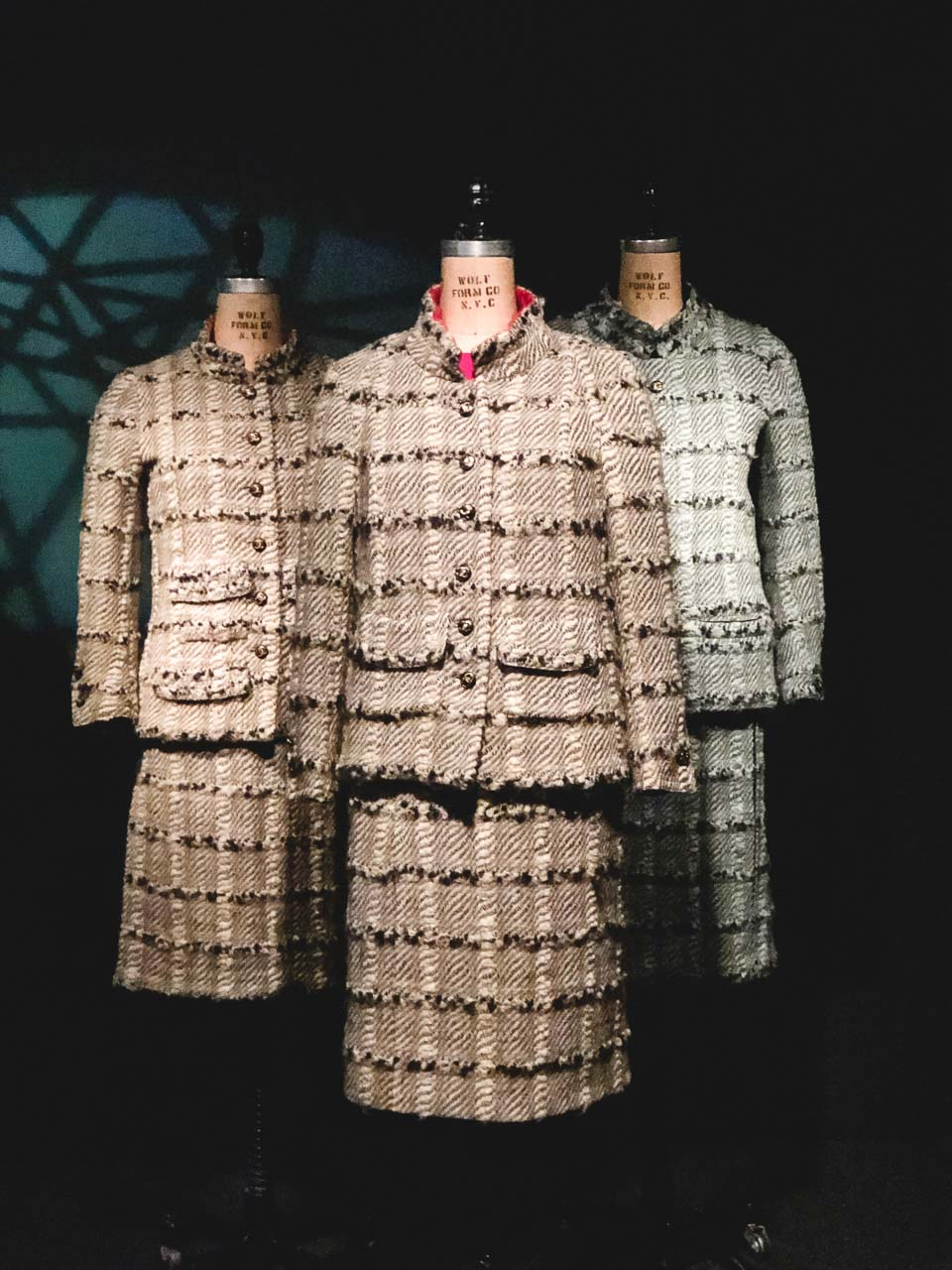Three Chanel tweed suits (an original, licensed copy and a counterfeit) on display at the Museum at the Fashion Institute of Technology in New York