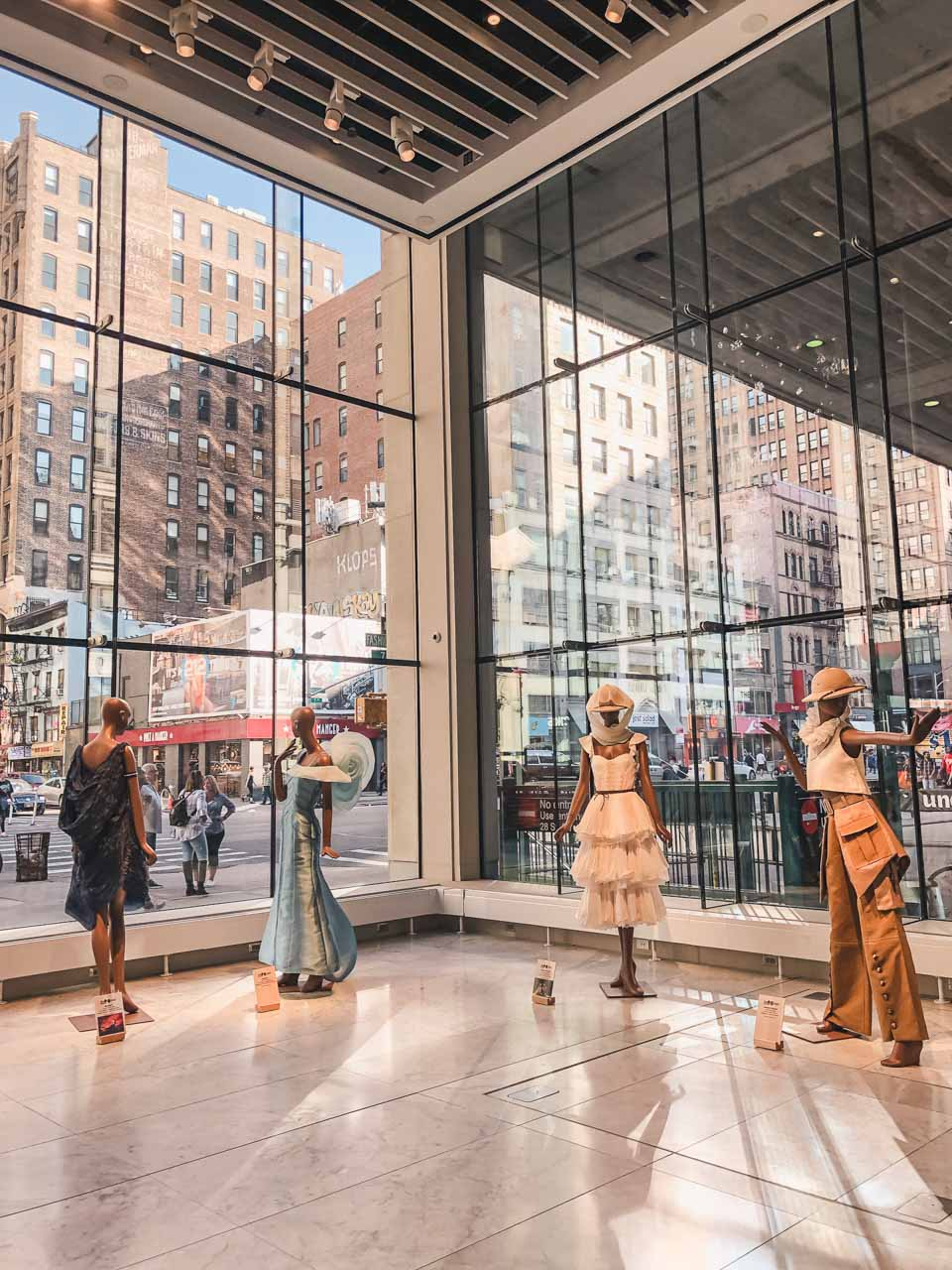 Outfits at the Disney on Broadway x FIT Design Challenge Exhibition in New York