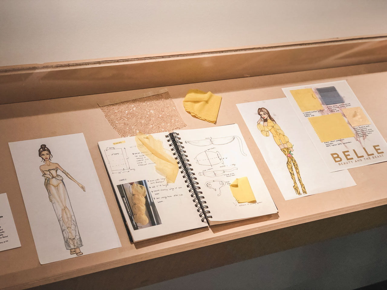 Sketches and a mood board at the Disney on Broadway x FIT Design Challenge Exhibition in New York