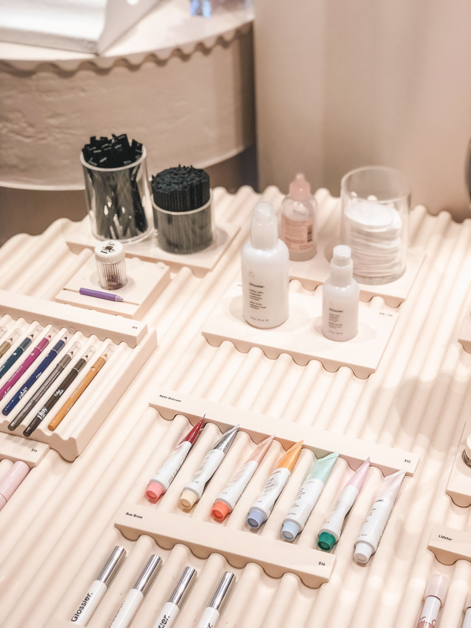 Milky jelly cleansers and lip balms on display inside the Glossier flagship store in New York City