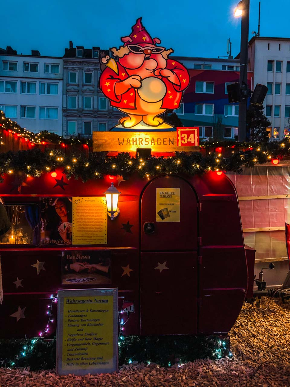 A trailer offering readings at the St. Pauli Christmas market in Hamburg