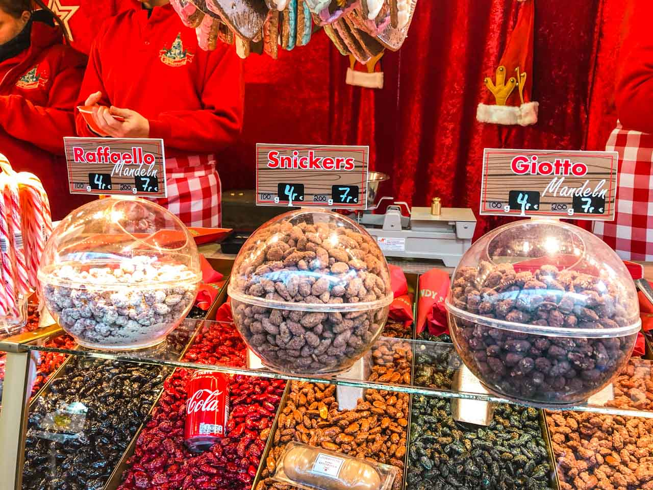 Different flavours of roasted almonds on display at a Hamburg Christmas market