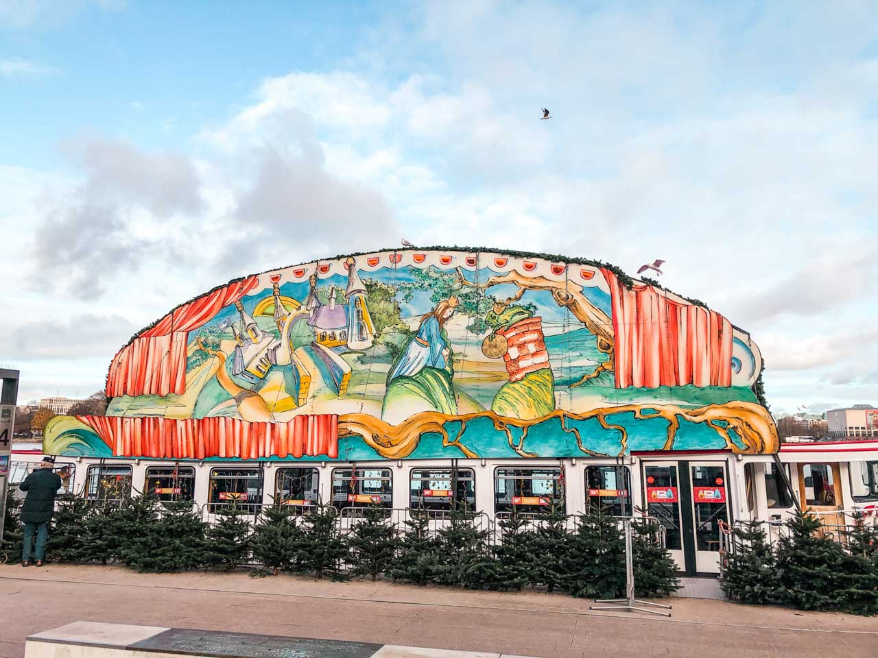 A decorated Fairytale Ship located on the Jungfernstieg Alster jetty in Hamburg