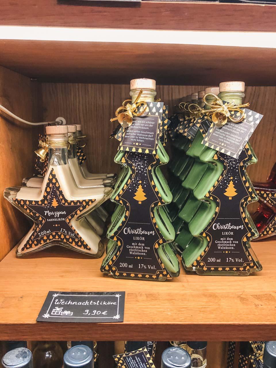 Christmas liquor in bottles in the shape of Christmas trees