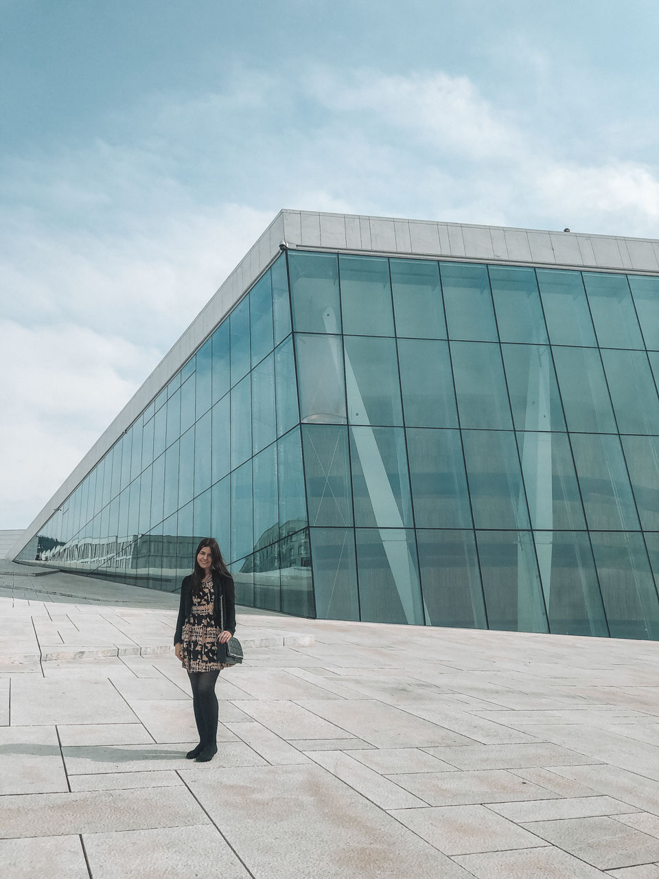 A girl standing by The Norwegian National Opera & Ballet in Oslo, Norway