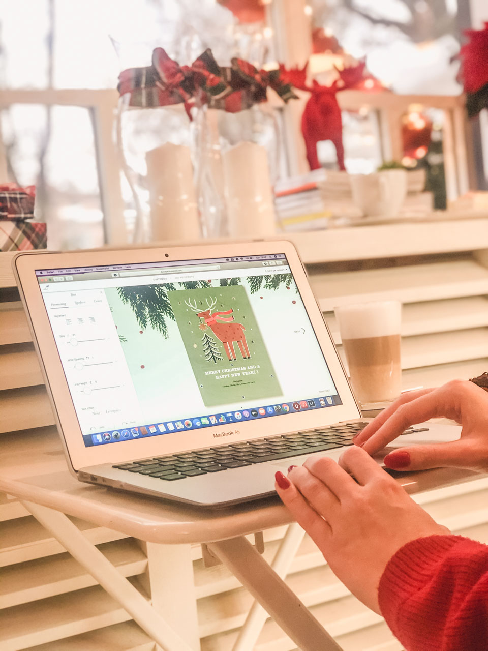 A girl customising a Paperless Post card on her laptop