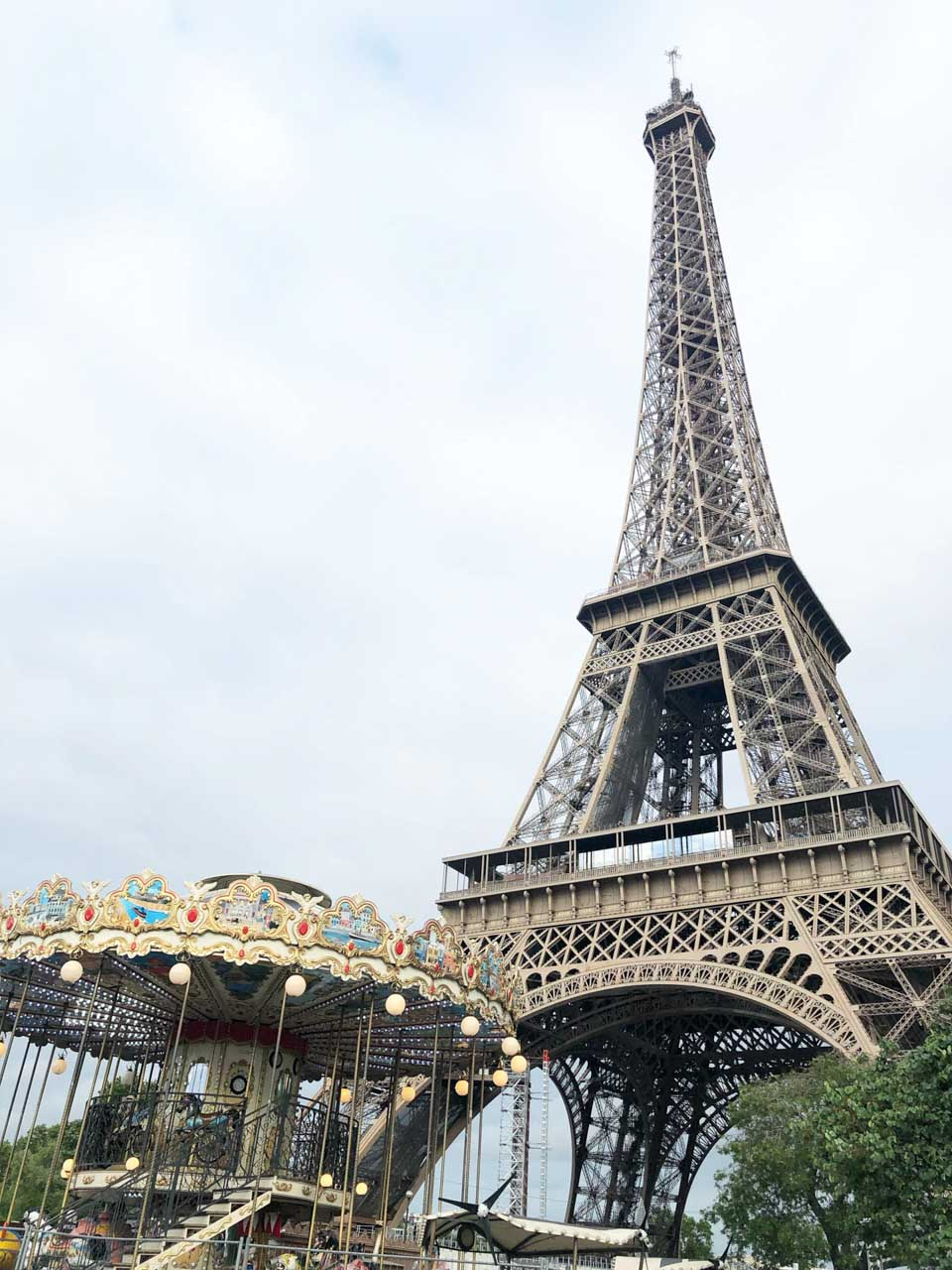 A carousel located right below the Eiffel Tower in Paris
