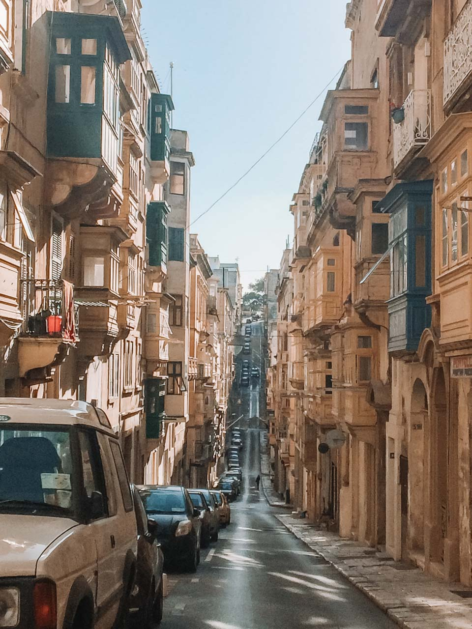A street lined with cars in Valletta, Malta