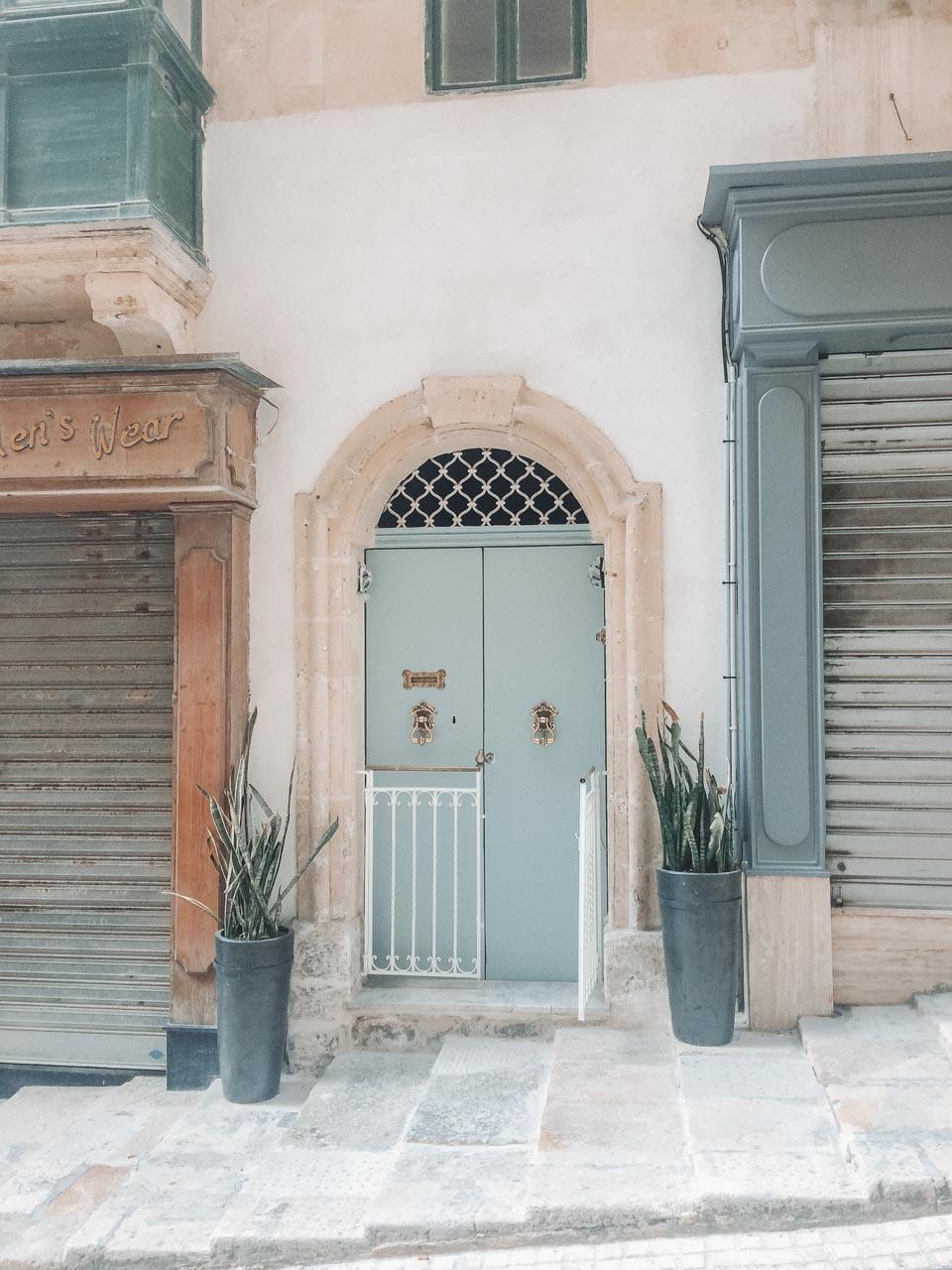 Pastel door in one of the streets of Valletta, Malta