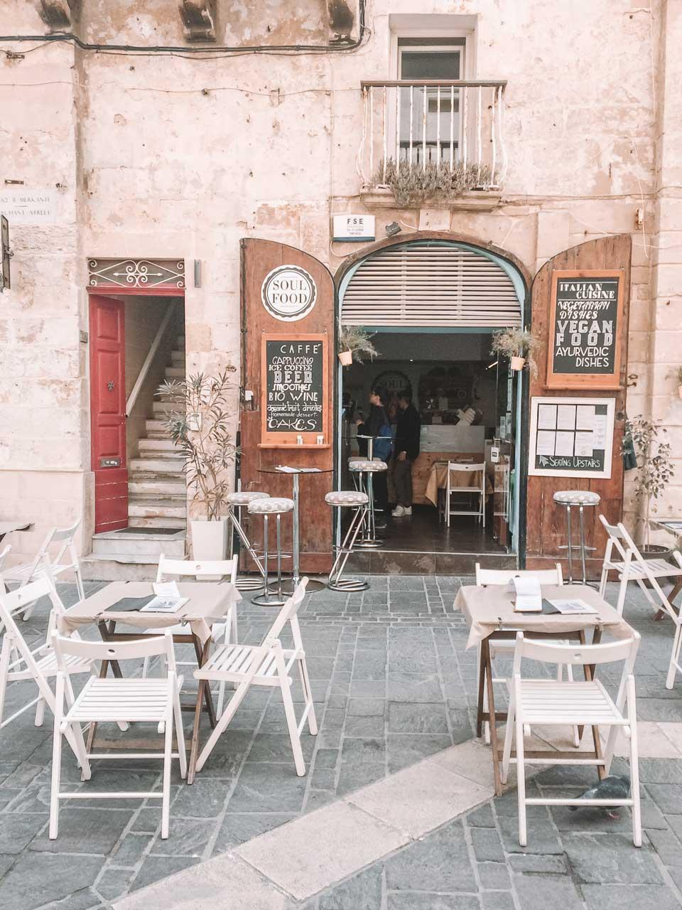 Tables outside a café in Valletta, Malta