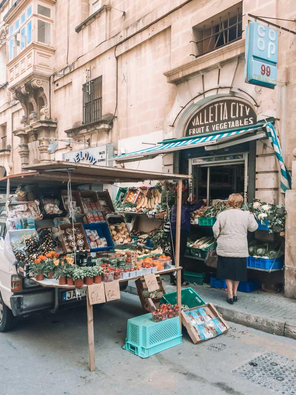 Street vendor selling fresh fruit and vegetables in Valletta, Malta