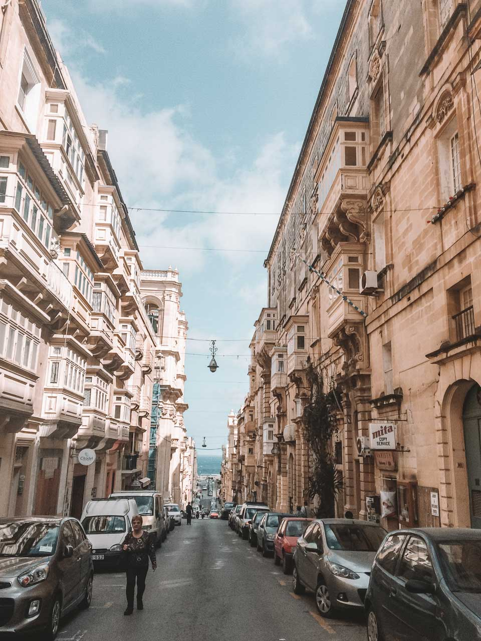A street in Valletta, Malta lined with cars
