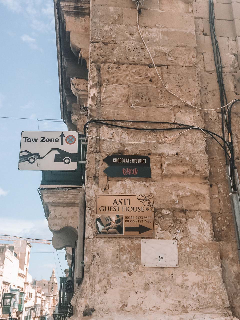 A street sign pointing to Chocolate District in Valletta, Malta