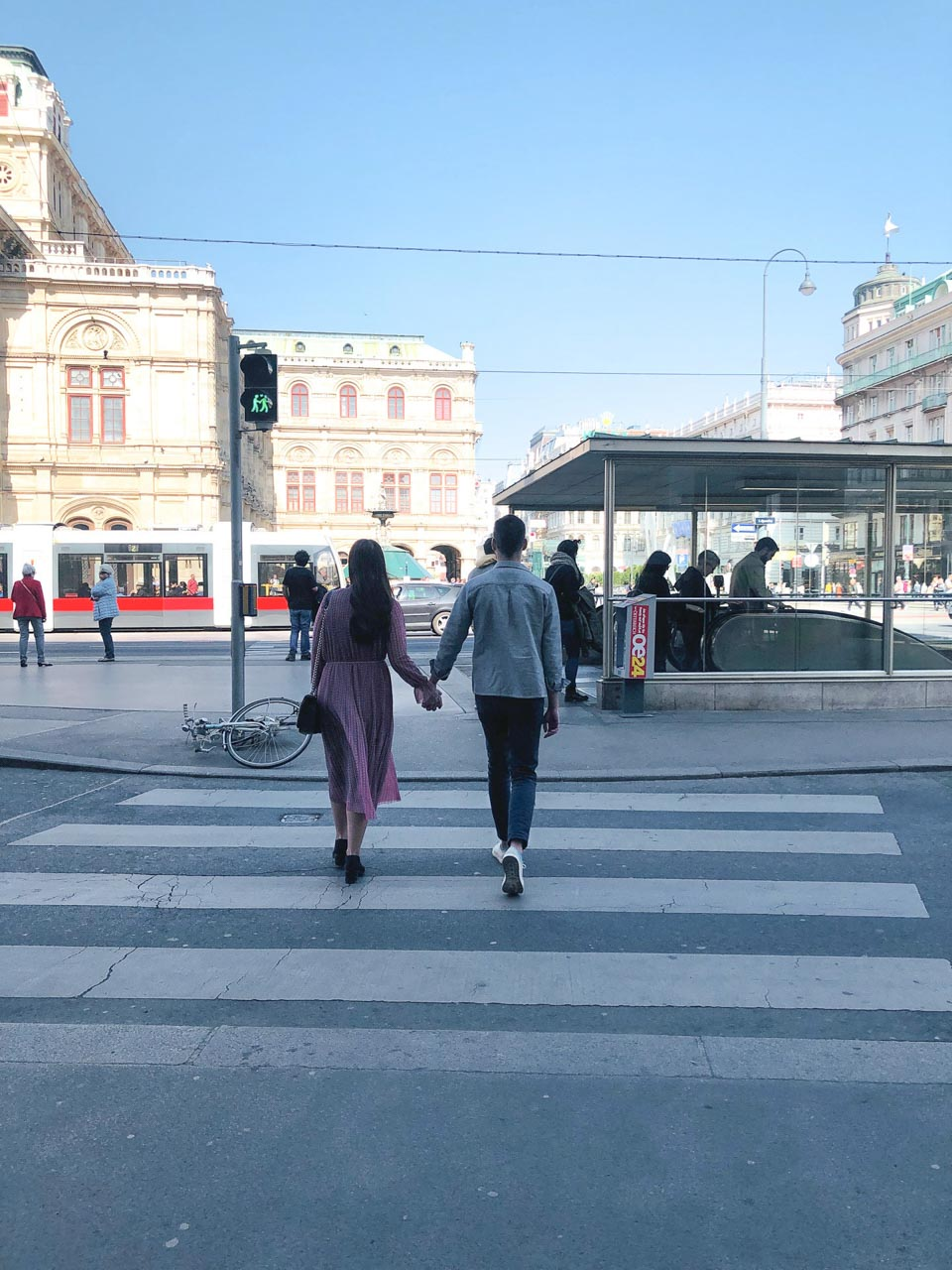 A couple crossing the street in Vienna, Austria