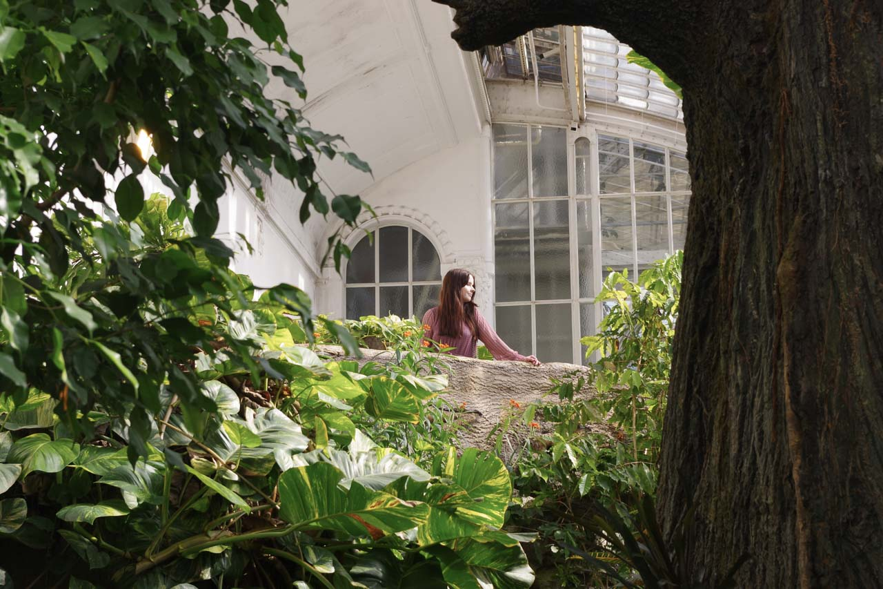 A girl looking at butterflies at Schmetterlinghaus in Vienna, Austria