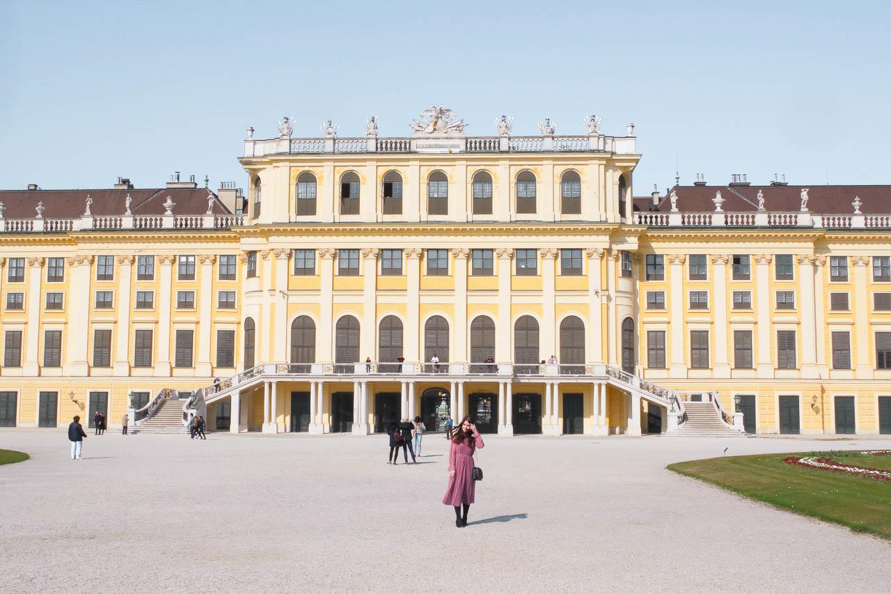 A girl standing outside the Schönbrunn Palace in Vienna, Austria