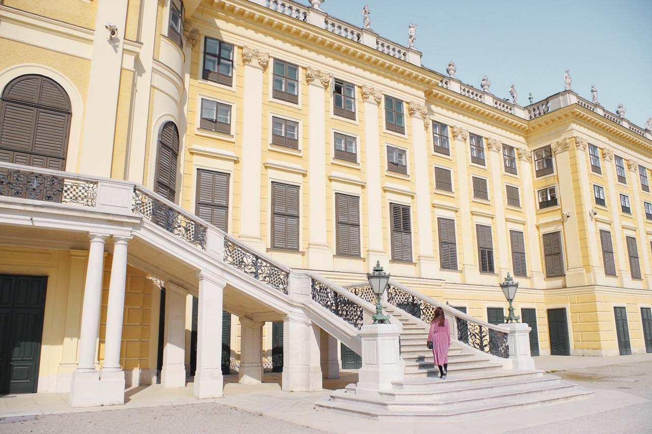 A girl on the steps of the Schönbrunn Palace in Vienna, Austria