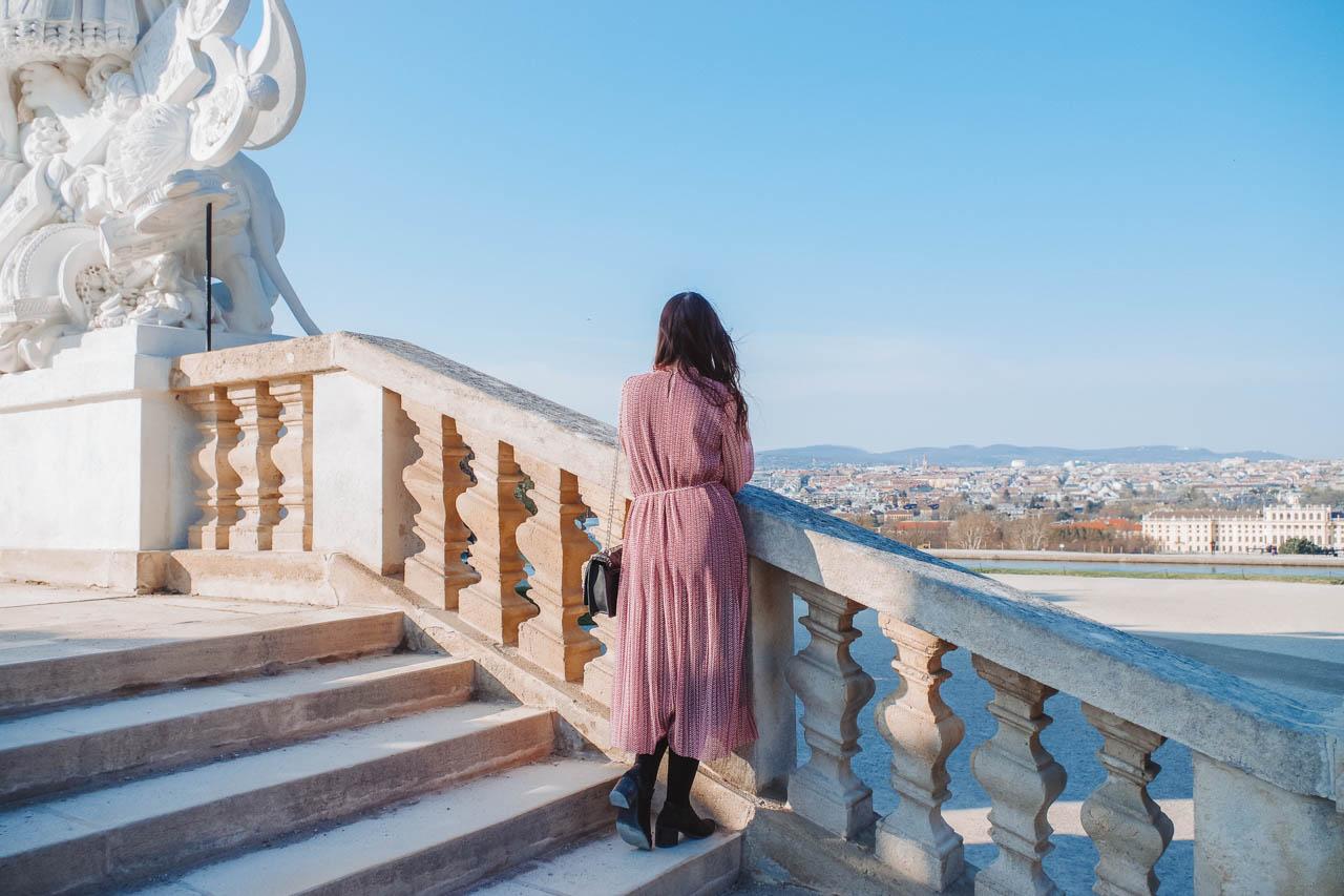 A girl standing by Café Gloriette in Schönbrunn Palace in Vienna, Austria