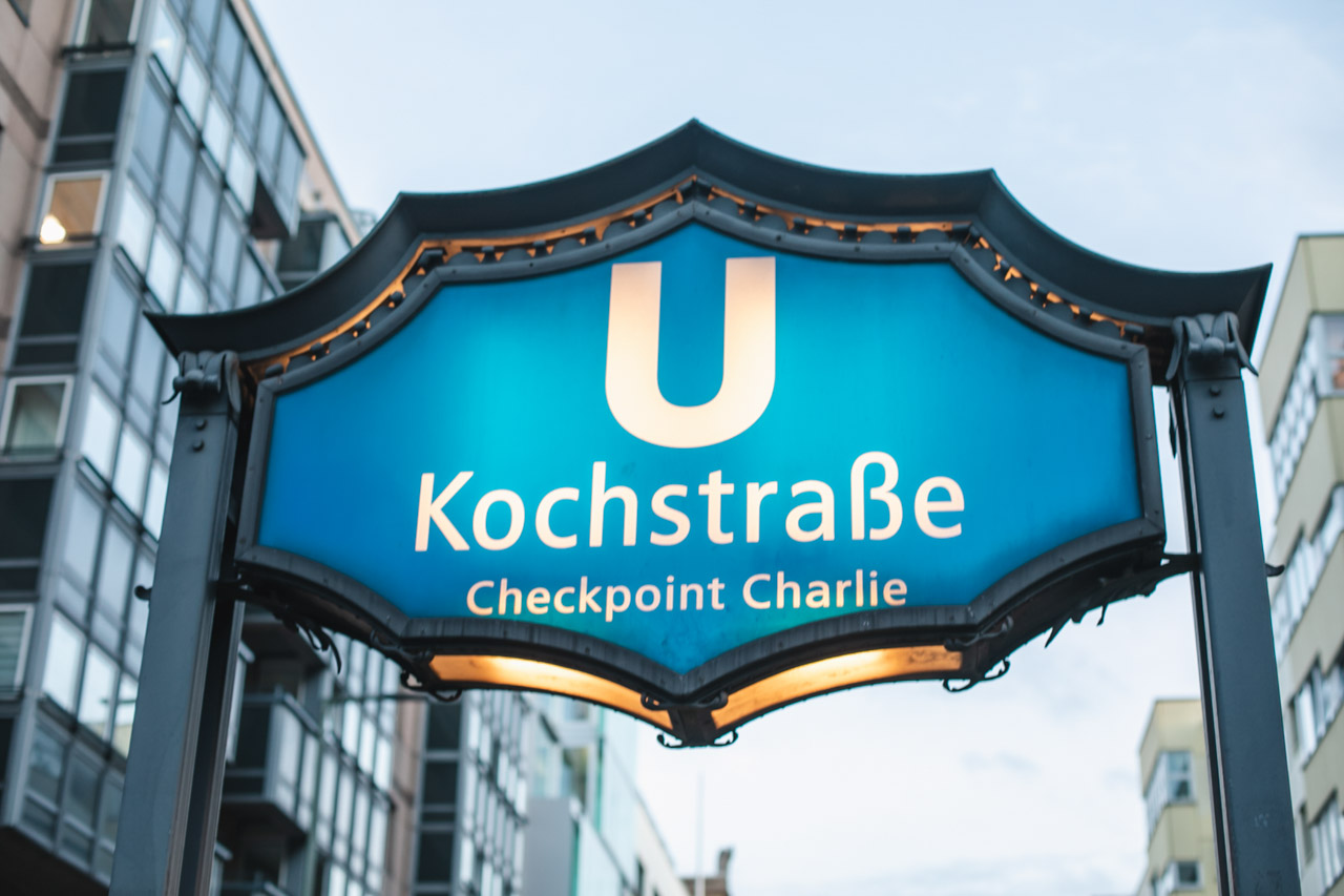 A close-up shot of the sign above the entrance to the Kochstrasse U-Bahn station in Berlin
