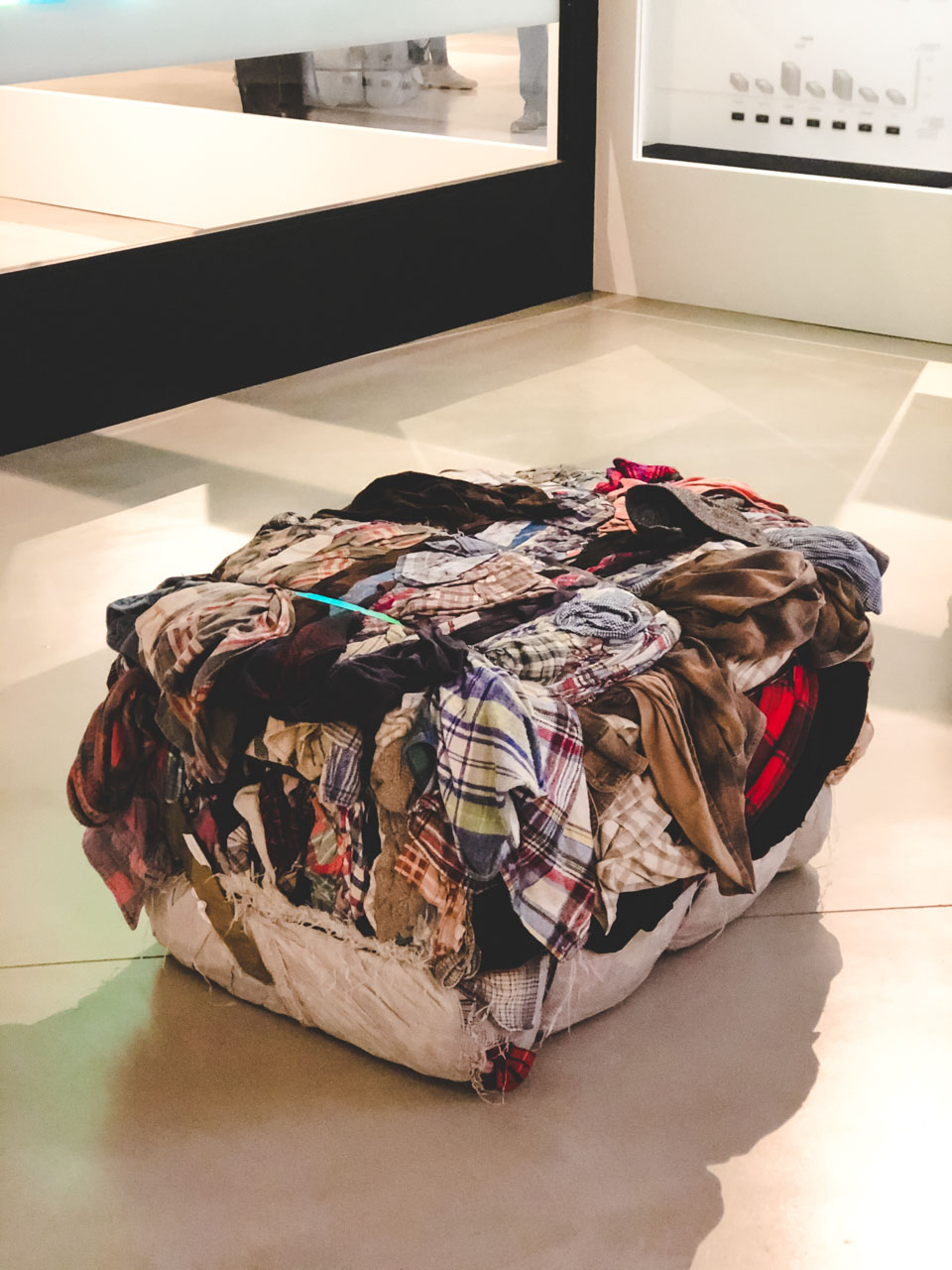 A seat made of a clothing bale at The Dark Sides of Fashion exhibition