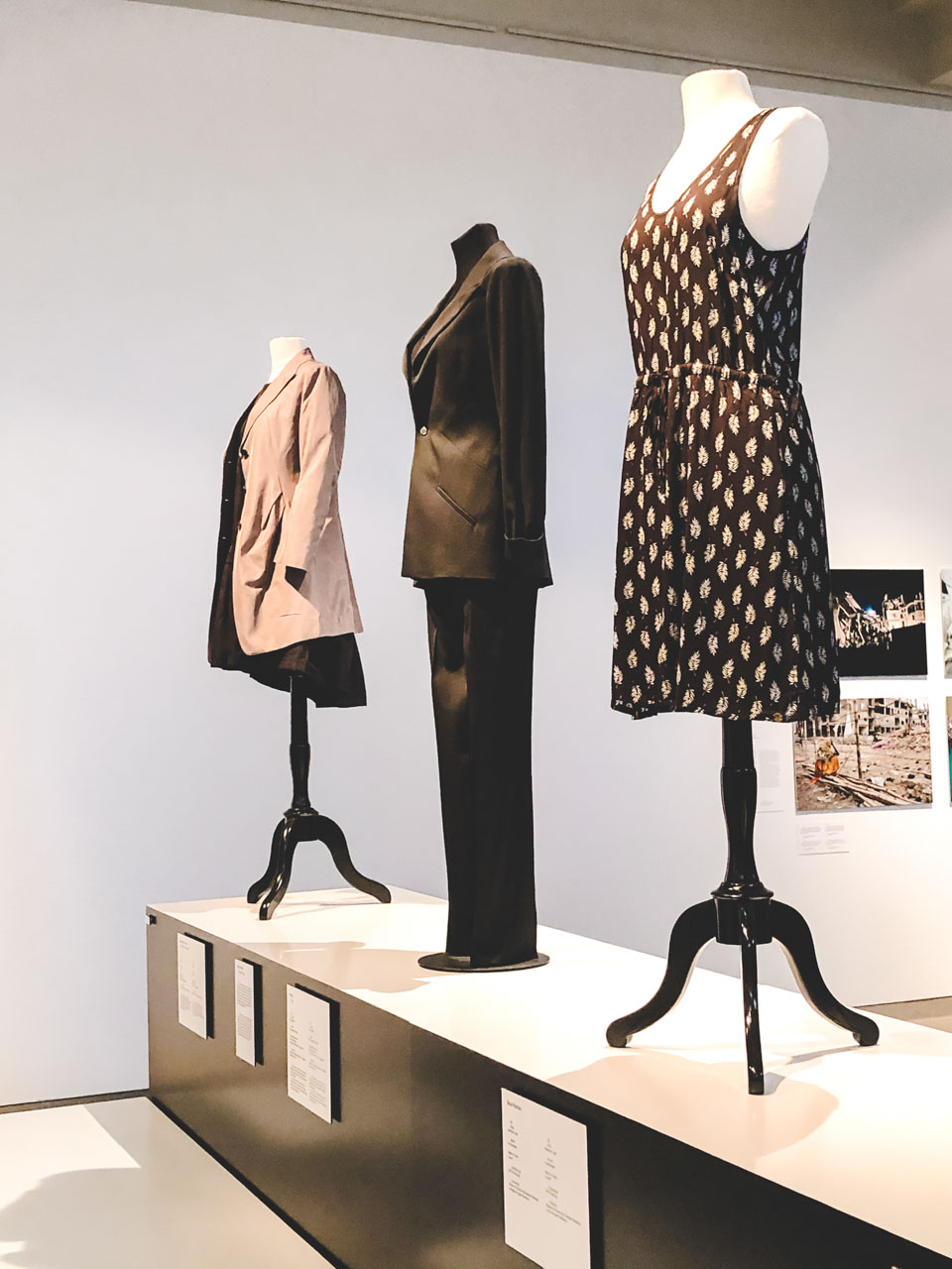 Dresses, a suit and a blazer on display at the Museum of European Cultures in Berlin