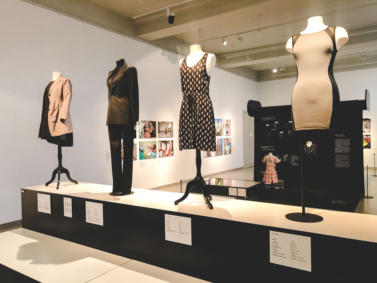Dresses, a blazer and a suit on display at the Museum of European Cultures in Berlin