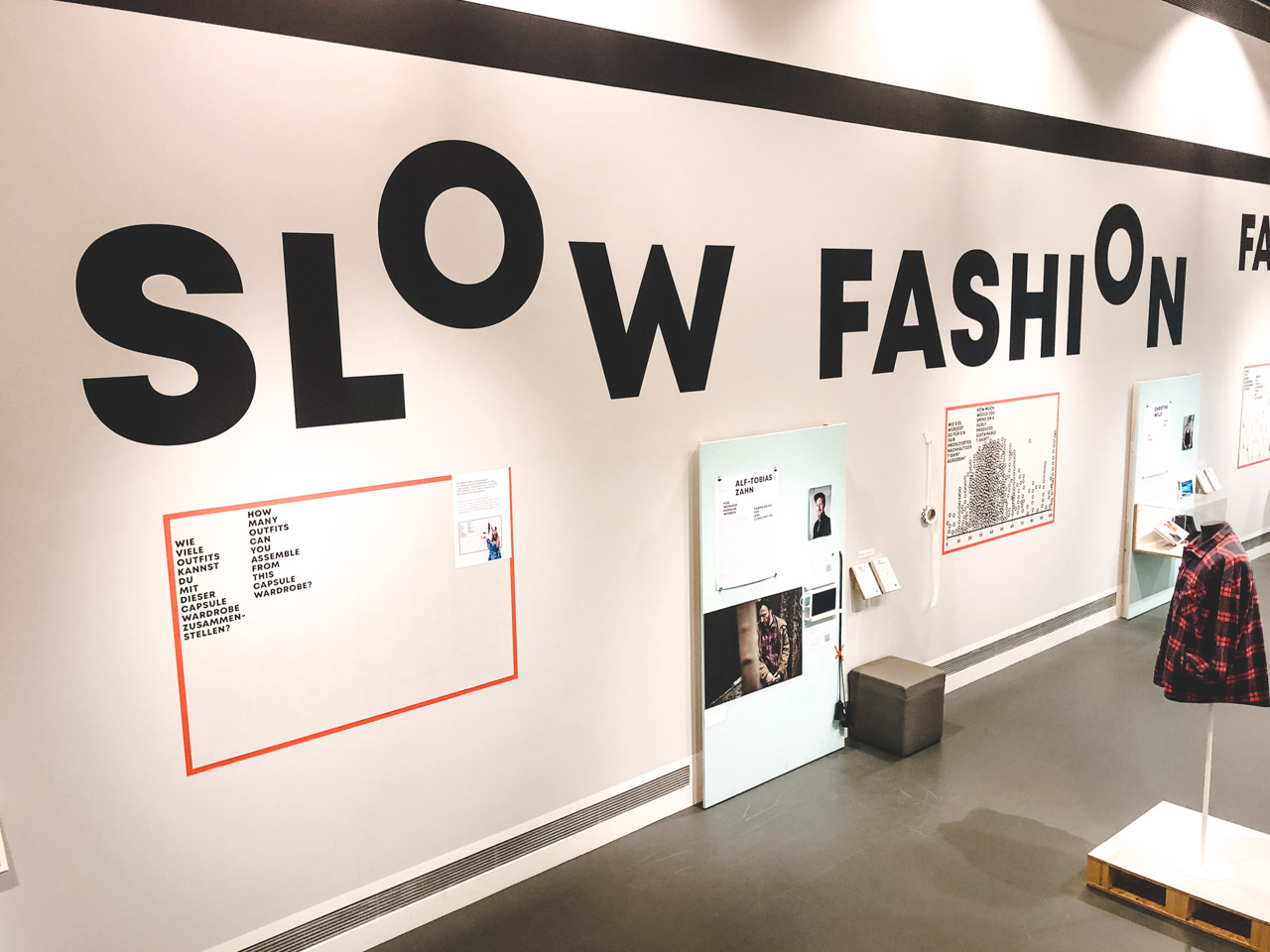 "A wall with ""Slow Fashion"" written on it inside the Museum of European Cultures"