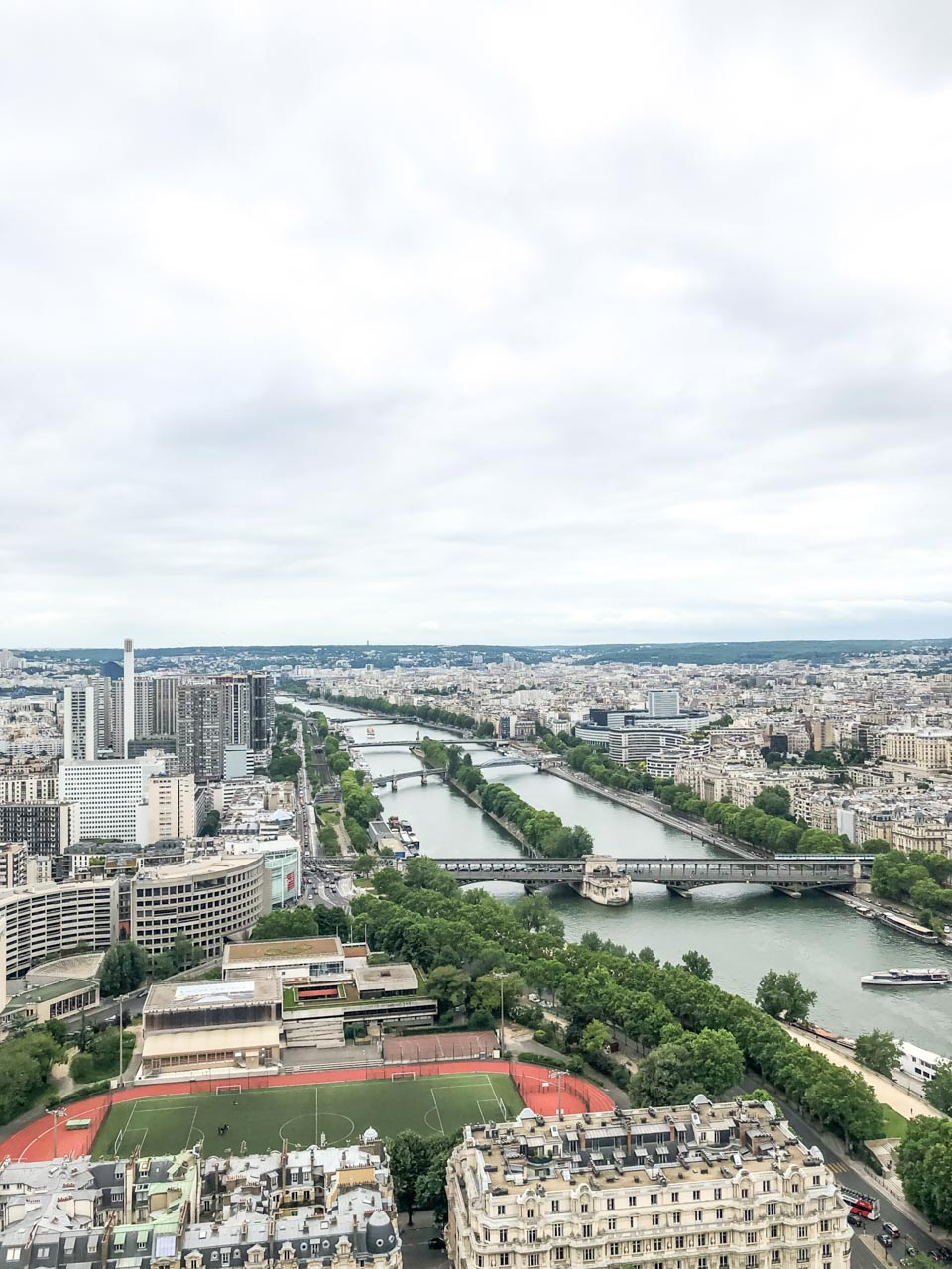 An aerial view of various bridges on the Seine River seen from the 2nd floor of the Eiffel Tower in Paris, France