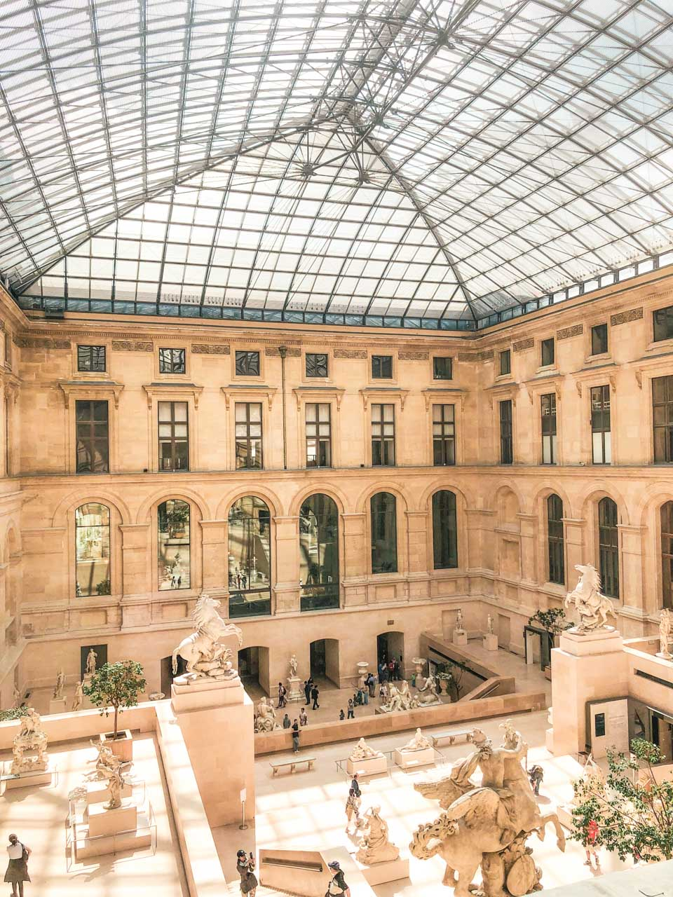 The Cour Marly sculpture courtyard in the Louvre Museum in Paris, France