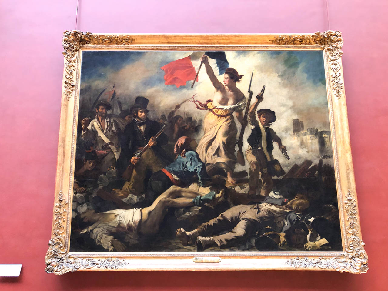 Liberty Leading the People by Eugène Delacroix hanging on the wall in the Louvre Museum in Paris, France