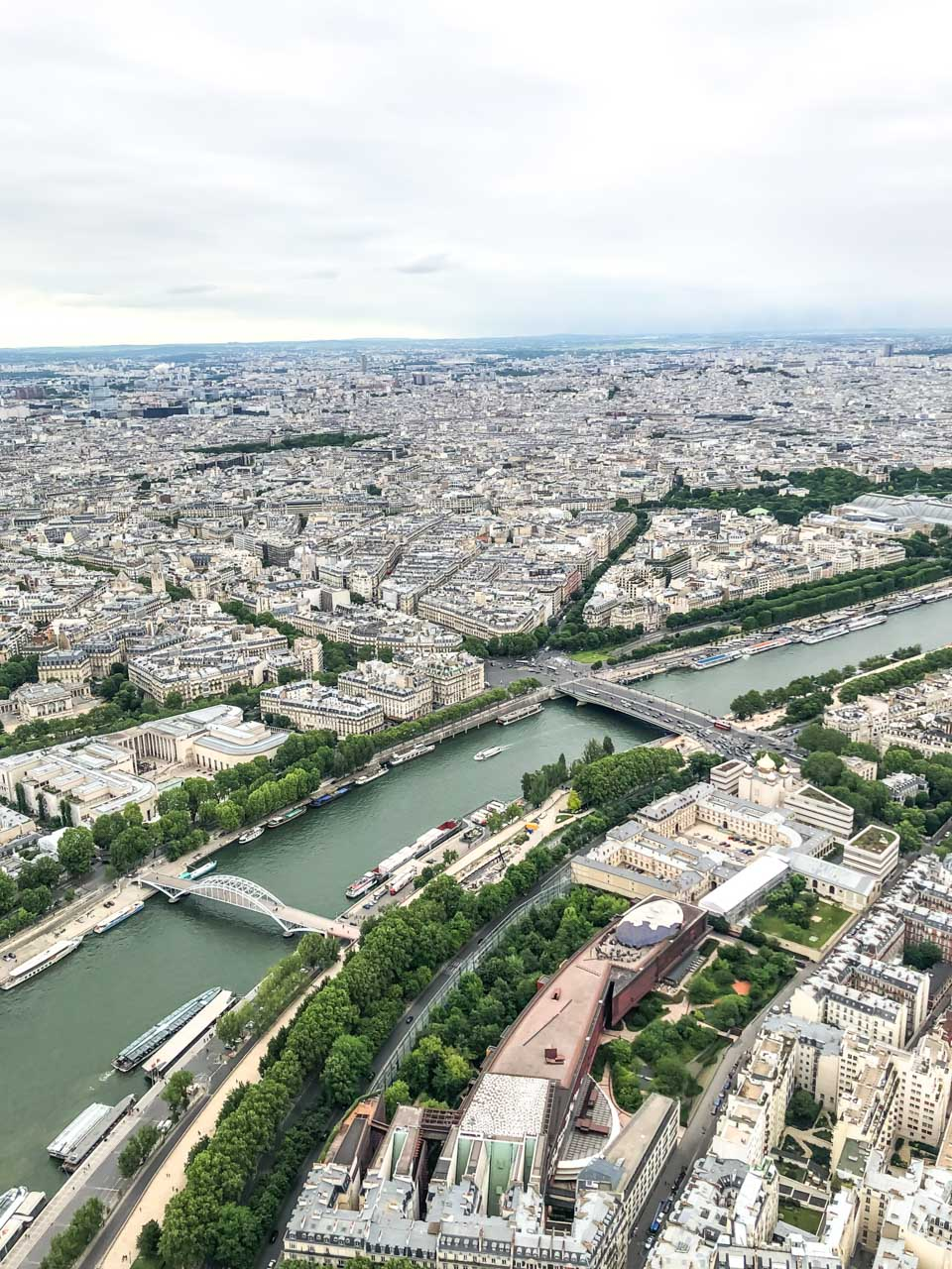 A panoramic view of the Seine River dividing Paris into two banks seen from the observation deck at the top of the Eiffel Tower