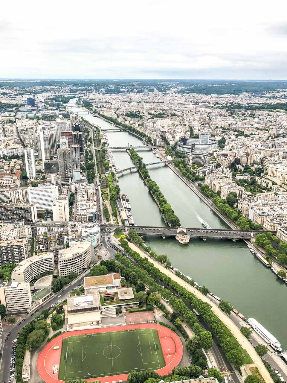 An aerial view of various bridges on the Seine River seen from the top of the Eiffel Tower in Paris, France